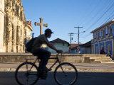 Granada  Man Riding Bike Past Iglesia De La Merced  Nicaragua