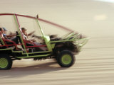 Dune Buggy Speeds Tourists Acoss Through the Sand Dunes Near Huacachina  in Southern Peru