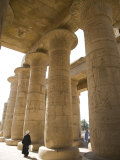Man Walks Underneath the Giant Columns of the Hypostyle Hall in the Ramesseum  Luxor