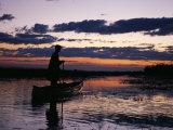 Zambia Game Scout Poling Mokorro Along Lukulu River at Sunset