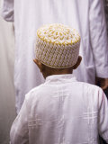Boy Follows His Father Through the Crowds Outside the Sayyida Ruqayya Mosque  Damsacus  Syria
