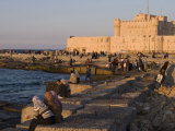 Friends and Couples Gather at Sunset Outside the Citadel of Quatbai  Alexandria  Egypt