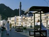 Omanis Walk and Sit Alongside Muttrah's Busy Corniche