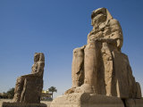 Colossi of Memnon Stand at Entrance to the Ancient Theban Necropolis on West Bank of Nile at Luxor
