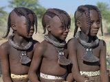 Three Young Girls  their Bodies Lightly Smeared with Red Ochre Mixture  Namibia