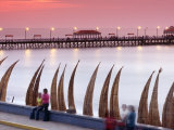 Waterfront Scene at Huanchaco in Peru  Locals Relax Next to Totora Boats Stacked Along the Beach