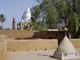 Grave of Al-Mahdi Lies Beneath the Large Mausoleum in Back  His Former Home Is in Foreground  Sudan