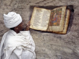 Priest of Ethiopian Orthodox Church Reads Old Bible at Rock-Hewn Church of Yohannes Maequddi