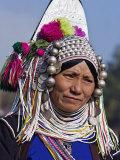 Burma  Kengtung  A Mong La Akha Woman Wearing a Traditional Headdress of Silver and Beads  Myanmar