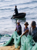 Carrying Fishing Nets Up the Beach after the Day&#39;s Work