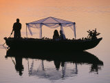 Bride and Groom Leaving a Wedding at Nkwali  Poled on African Gondola  Zambia
