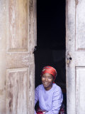 Woman Looks Out from Her Doorway on Ilha Do Mozambique