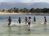 Children Enjoy a Boat Race in a Lagoon at Qalansiah  an Important Fishing Village in the Northwest