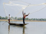 Fisherman Cast Hand Nets on the River Niger from Shallow-Draught Boats
