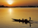 Mopti  at Sunset  a Boatman in a Pirogue Ferries Passengers across the Niger River to Mopti  Mali