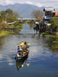 Young Novitiate Travels by Boat to His Induction as Novice Buddhist Monk  Lake Inle  Burma  Myanmar