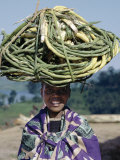 Young Girl Carries Coils of Green 'Rope' to Market Balanced on Her Head