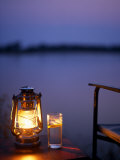 Gin and Tonic by the Light of Hurricane Lamp  Looking Out over the Zambezi River  Zambia