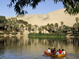 Family Rows Out onto the Oasis Lagoon of Huacachina  Near Ica in Southern Peru