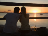 Queensland  Fraser Island  A Couple with Video Camera in Hand Watch Sunset from a Pier  Australia