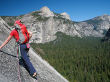 Rock Climber Ascends Slabs at the Base of the Huge Cliff known as the Apron  Yosemite Valley