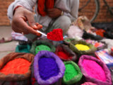 Dye Trader Offers His Brightly Coloured Wares in a Roadside Stall in Kathmandu  Nepal  Asia
