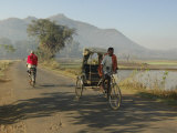 Early Morning Rickshaw Wallahs Pass Each Other in Rural Countryside Near Baliguda  Orissa