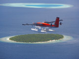 Maldivian Air Taxi Flying Above Island  Maldives  Indian Ocean  Asia