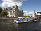Tour Boat on River Cruise on the Spree River Passing the Reichstag  Berlin  Germany