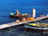 Fisherman and His Wife Cleaning the Fishing Nets in Boat and Jetty  Corfu  Greek Islands  Greece