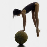 Woman Balancing on Globe