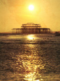 Sun over Ruin of West Pier  Brighton  Sussex  England