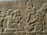 Soldiers Eating  from Military camp  relief  7th century BC Assyrian