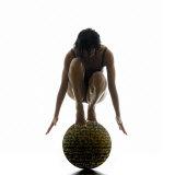 Woman Balancing on Globe Papier Photo par Alfonse Pagano