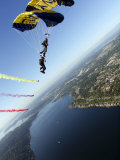Members of US Navy Parachute Team  the Leap Frogs  Perform Bi-Plane with Parachutes Above Seattle