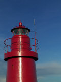 A Red Lighthouse with Blue Sky