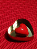 Heart Shaped Box Containing a Love Stone with Strong Red Background