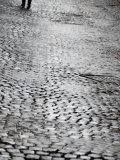 Person's Feet Walking Down Cobblestone Street in Rome  Italy