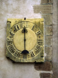 Old Stone Clock on Wall of Old Building