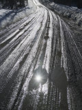 Muddy Wet Road Reflecting the Sunlight