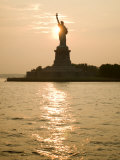Sun Setting Behind the Statue of Liberty on a Summer Evening