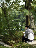 Young Woman Reading by a Lily Pond in the Jing&#39;An Park