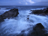 High Tide Brings in Waves on a Rocky Shoreline