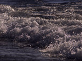 Frothy Wave Spills onto the Shore of Lake Superior