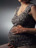 Nine Month Pregnant Woman Holds Her Belly