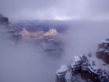 Winter Mist over a Snow-Blanketed Grand Canyon Landscape