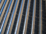 Oil Piped Down Long Rows of Reflectors Soaks Up Focused Sunlight