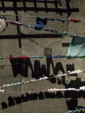 Laundry on Clotheslines Casts Shadows Outside a Housing Complex