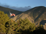 American Flag Flies High over the Mountains in Red Lodge  Montana