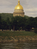 Capitol Building with a Gilded Dome on the Banks of a River